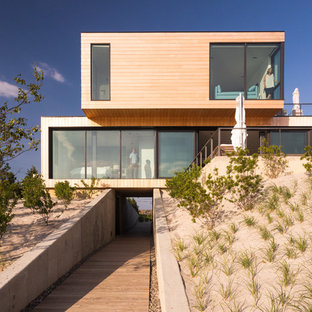 Example of a huge minimalist exterior home design in New York