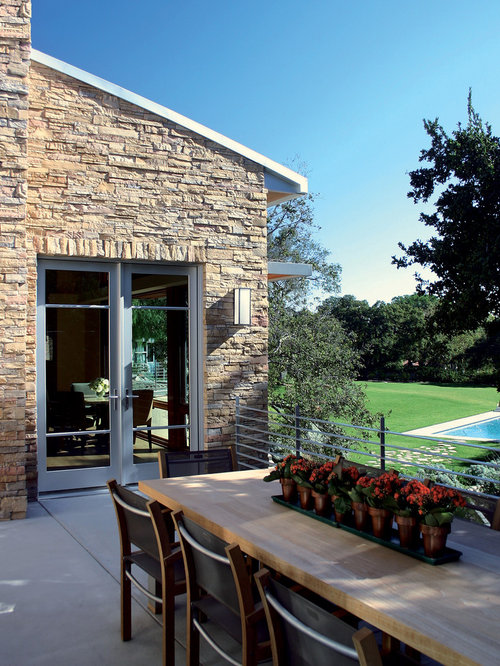 elegant stone exterior home photo in los angeles - Faux Stone Veneer