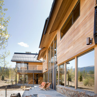 Large minimalist brown two-story mixed siding exterior home photo in Denver