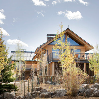 Inspiration for a large modern brown two-story mixed siding exterior home remodel in Denver