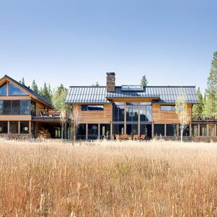 Example of a large minimalist brown two-story mixed siding exterior home design in Denver