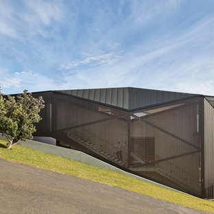 Modern grey exterior in Sydney with a metal roof.
