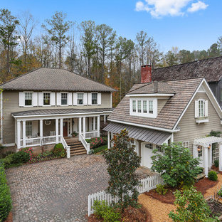 Large traditional gray two-story wood exterior home idea in Atlanta