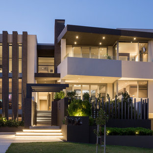 Contemporary stucco beige house exterior in Perth with three or more storeys and a flat roof.