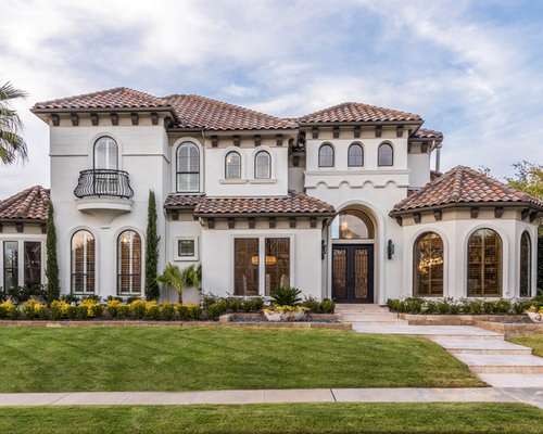 home designs pictures. Example of a large tuscan beige two story exterior home design in Dallas  with Mediterranean Home Design Photos Decor Ideas