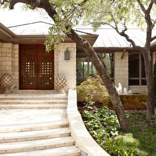Trendy stone exterior home photo in Austin