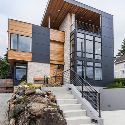 Large contemporary gray three-story mixed siding flat roof idea in Seattle