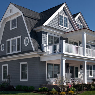 Example of a mid-sized beach style blue three-story wood gable roof design in Philadelphia