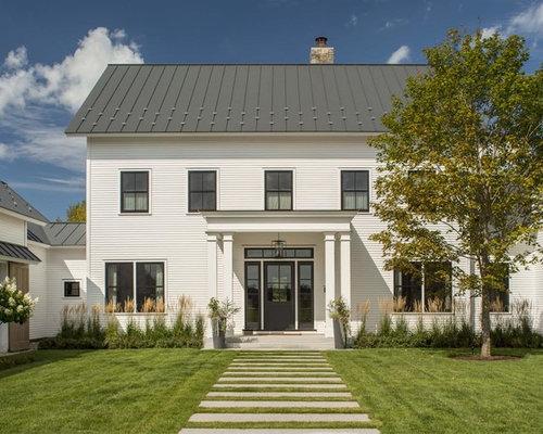 Foto e idee per facciate di case facciata di una casa for Piani di casa di campagna con cantina