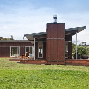 Coastal metal exterior home photo in Auckland