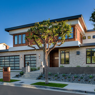 Contemporary multicolored two-story mixed siding flat roof idea in Orange County