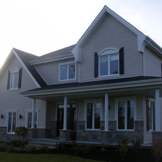 Traditional Exterior by Dessins RJC