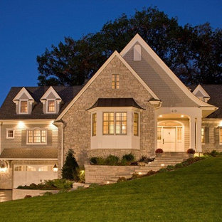 Traditional two-story wood exterior home idea in Minneapolis