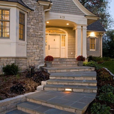 Example of a classic wood exterior home design in Minneapolis