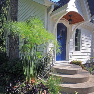 Inspiration for a small transitional one-story wood exterior home remodel in Milwaukee