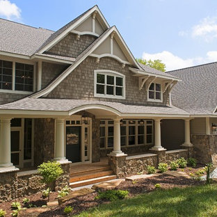 This is an example of a victorian two-storey grey exterior in Minneapolis with wood siding.