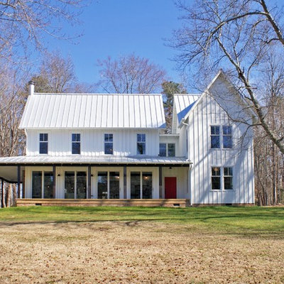 Farmhouse white two-story wood exterior home photo in Raleigh