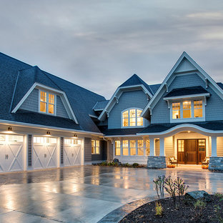Inspiration for a huge timeless gray two-story concrete fiberboard exterior home remodel in Minneapolis with a clipped gable roof