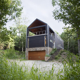 Inspiration for a contemporary black two-story exterior home remodel in New York
