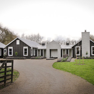This is an example of a gey rural one floor house exterior in Hamilton.