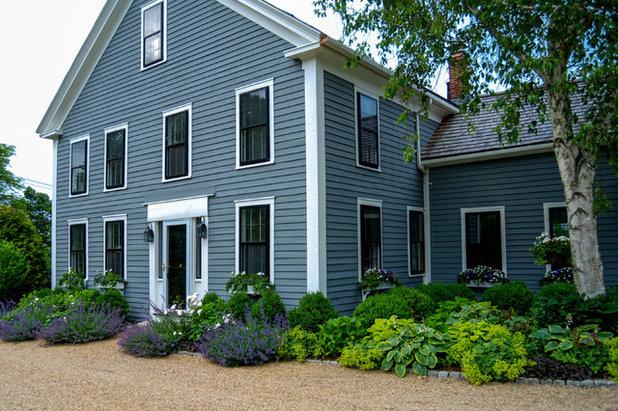 Farmhouse Exterior by a Blade of Grass
