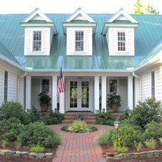 Farmhouse Exterior by Lotus Designs Landscaping