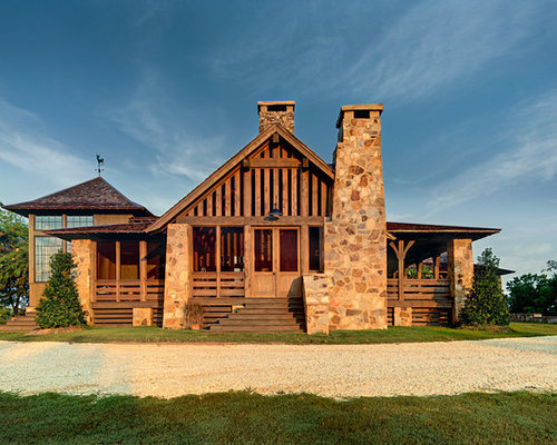 Inspiration For A Rustic Stone Exterior Home Remodel In Birmingham