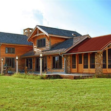 Rustic Exterior by New Energy Works Timberframers