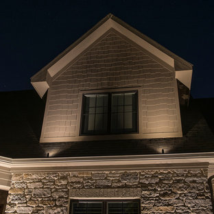 Inspiration for a huge transitional beige one-story mixed siding gable roof remodel in Indianapolis