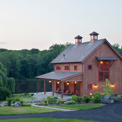Inspiration for a farmhouse wood exterior home remodel in DC Metro