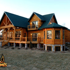 Rustic Exterior by Golden Eagle Log Homes