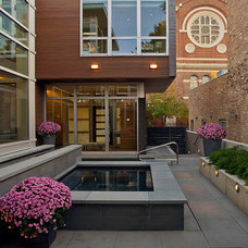 Contemporary Exterior by FRICANO CONSTRUCTION CO