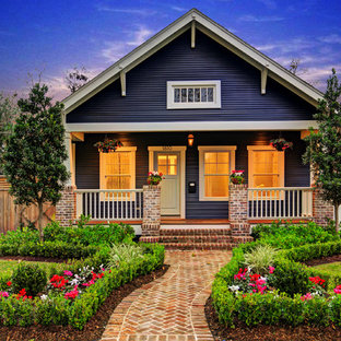 Inspiration for a mid-sized traditional two-storey blue exterior in Houston with wood siding and a gable roof.
