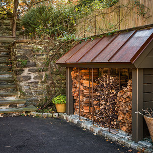 Inspiration for a large craftsman green two-story mixed siding house exterior remodel in Philadelphia with a clipped gable roof and a shingle roof