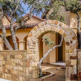 Mediterranean stucco exterior home idea in Austin