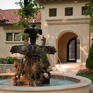 Example of a tuscan beige exterior home design in Other