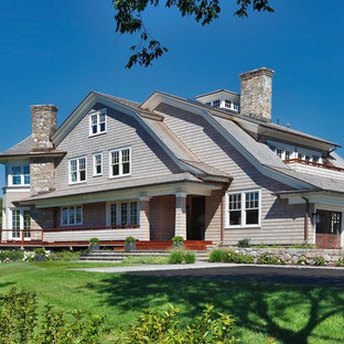 Example of a huge beach style gray three-story wood house exterior design in Other with a gambrel roof and a shingle roof