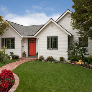 Small traditional one-storey white house exterior in San Diego with wood siding, a gable roof and a shingle roof.