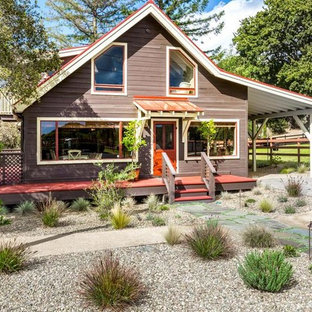 Inspiration for an expansive country two-storey brown house exterior in San Francisco with wood siding and a metal roof.