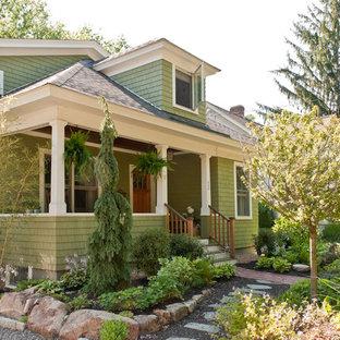 Craftsman green exterior home idea in Boston