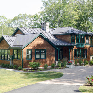 Huge arts and crafts brown two-story wood house exterior photo in Bridgeport with a metal roof