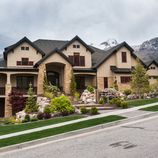 Example of an arts and crafts beige two-story mixed siding exterior home design in Salt Lake City