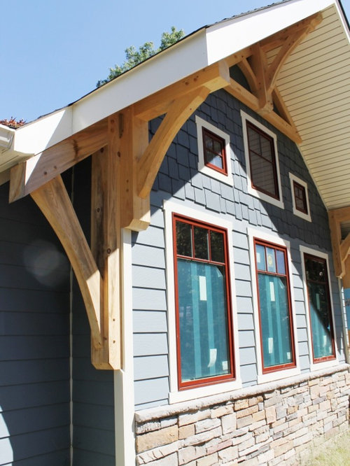 Craftsman exterior design ideas remodels photos with a Craftsman roofing