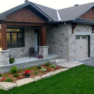 Mid-sized craftsman beige one-story mixed siding gable roof idea in Toronto