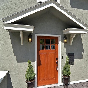 Craftsman Front Door With Portico And Urns With Topiaries