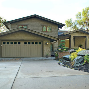 Mid-sized arts and crafts green split-level wood exterior home photo in Minneapolis
