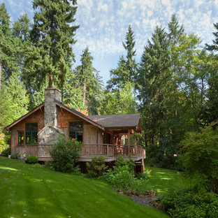 Arts and crafts stone exterior home photo in Seattle