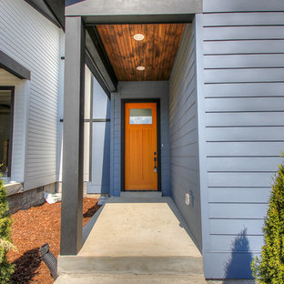 Mid-sized trendy blue two-story vinyl exterior home photo in Nashville with a shed roof