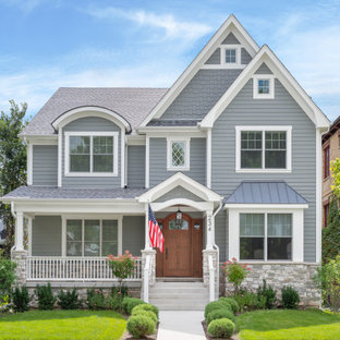 Large traditional gray two-story vinyl house exterior idea in Chicago with a hip roof and a shingle roof