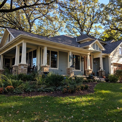 Mid-sized craftsman blue two-story mixed siding exterior home idea in Chicago with a shingle roof
